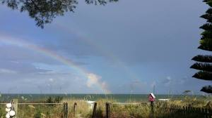 Stormy morning offshore results in a gorgeous double rainbow!